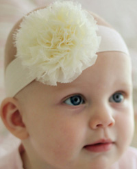Claire baby headband on wide elastic