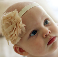 Madeline baby headband on cream elastic