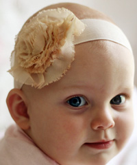 Madeline baby headband on wide elastic