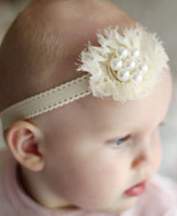 Pearl baby headband on cream elastic