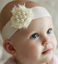 Pearl baby headband on wide elastic